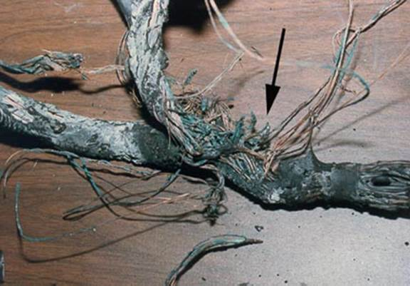 design problem chaffing of electrical wire insulation following this add on wire which lead to the point of origin of the fire verified an unsecured condition that was subject to vibration and consequent